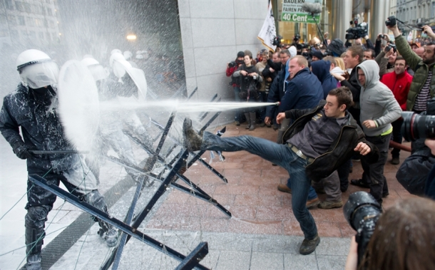 Angry-farmers-protesting-at-falling-dairy-prices-in-the-EU-have-sprayed-fresh-milk-at-the-European-Parliament-and-riot-police-in-Brussels